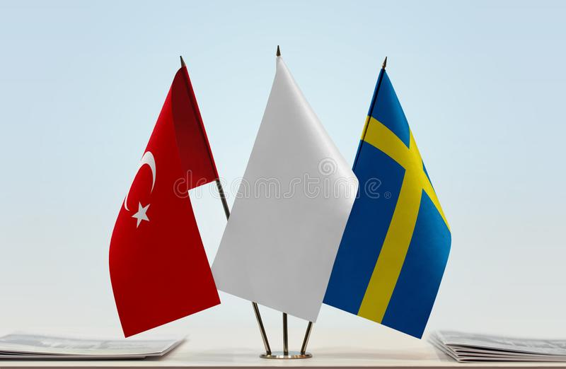 Flags of Turkey and Sweden. Desktop flags of Turkey and Sweden with a white flag in the middle royalty free stock photography