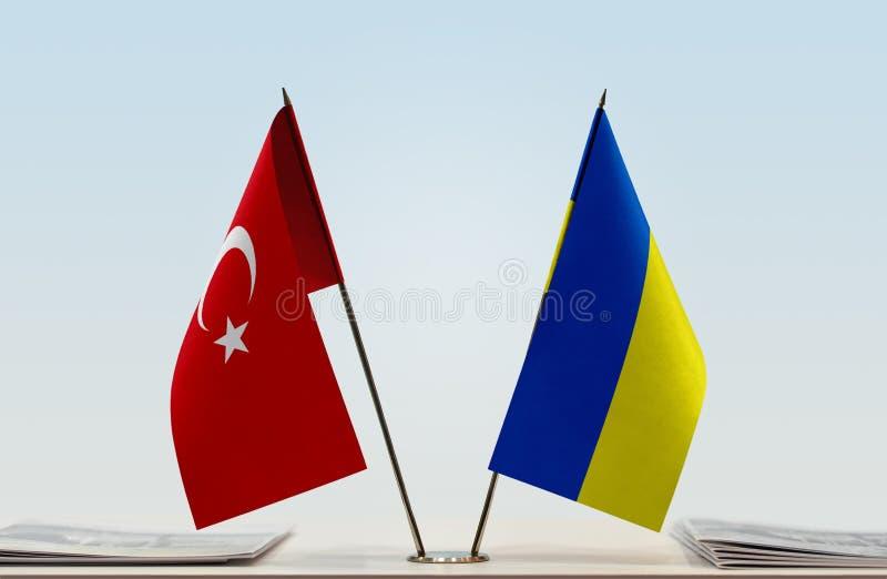 Flags of Turkey and Ukraine. Desktop flags of Turkey and Ukraine on bright background royalty free illustration