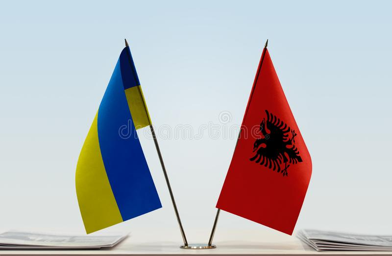 Flags of Ukraine and Albania. Desktop flags of Ukraine and Albania on bright background royalty free stock image