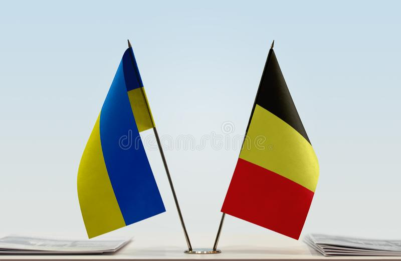 Flags of Ukraine and Belgium. Desktop flags of Ukraine and Belgium on bright background royalty free stock photography