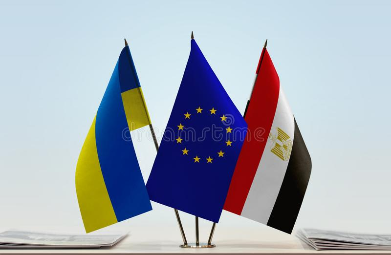 Flags of Ukraine EU and Egypt. Desktop flags of Ukraine and Egypt with European Union flag in the middle stock photos