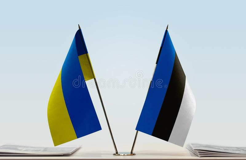 Flags of Ukraine and Estonia. Desktop flags of Ukraine and Estonia on bright background royalty free stock photography