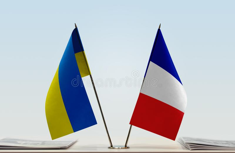 Flags of Ukraine and France. Desktop flags of Ukraine and France on bright background stock photography