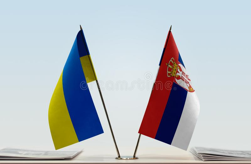 Flags of Ukraine and Serbia. Desktop flags of Ukraine and Serbia on bright background stock image