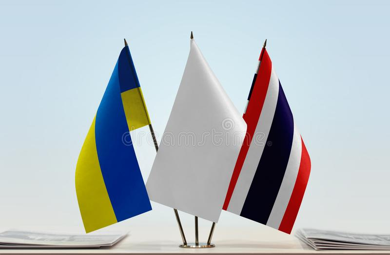 Flags of Ukraine and Thailand. Desktop flags of Ukraine and Thailand with white flag between stock photos