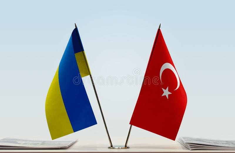 Flags of Ukraine and Turkey. Desktop flags of Ukraine and Turkey on bright background royalty free stock photo