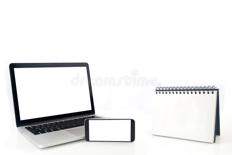 Desktop Loop wire binding book and blank screen of notebook ,cell phone, tablet, smartphone on isolated white background. Concept of business connection stock photos