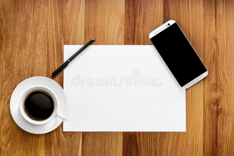 Desktop mix smartphone and pen royalty free stock image