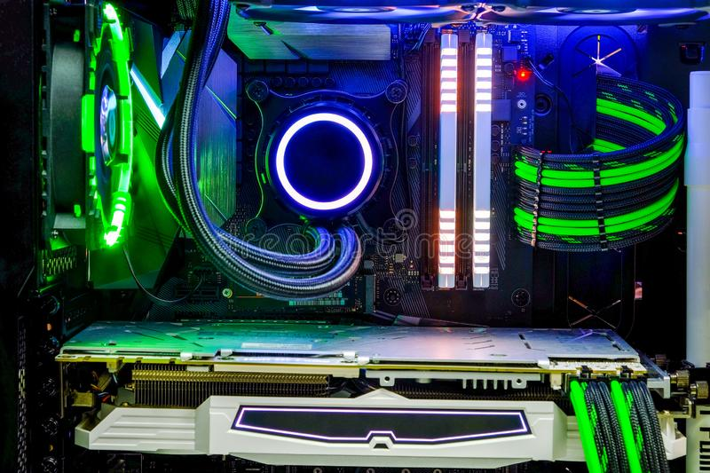Desktop PC Gaming and liquid cooling cpu with LED RGB light show status on working mode. Close-up Desktop PC Gaming and liquid cooling cpu with LED RGB light stock images