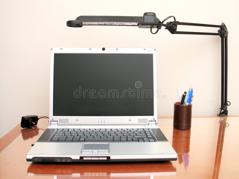 Desktop Set-Up. A desktop with a notebook computer as its main subject
