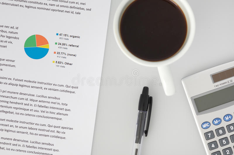 Office Desk with Report Pen Calculator Coffee royalty free stock photo