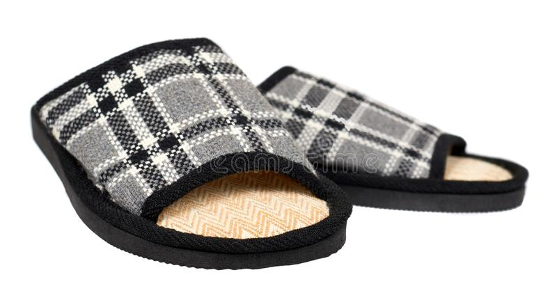 Deslizadores listrados do algodão, calçados da criança Fundo isolado imagem de stock