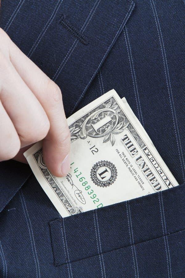 Deslizando o dinheiro no bolso fotografia de stock