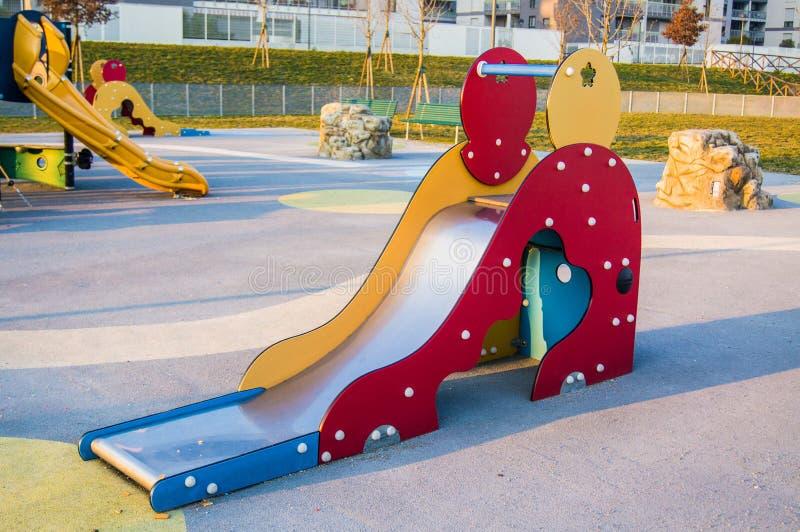 Deslize no campo de jogos no parque fotografia de stock royalty free