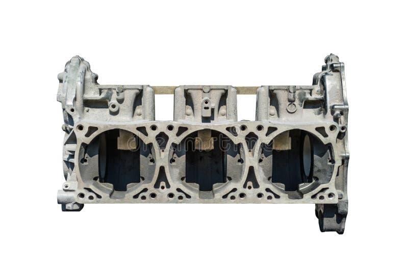 Desmontado de um bloco de motor do três-cilindro em um fundo branco com um trajeto de grampeamento fotos de stock