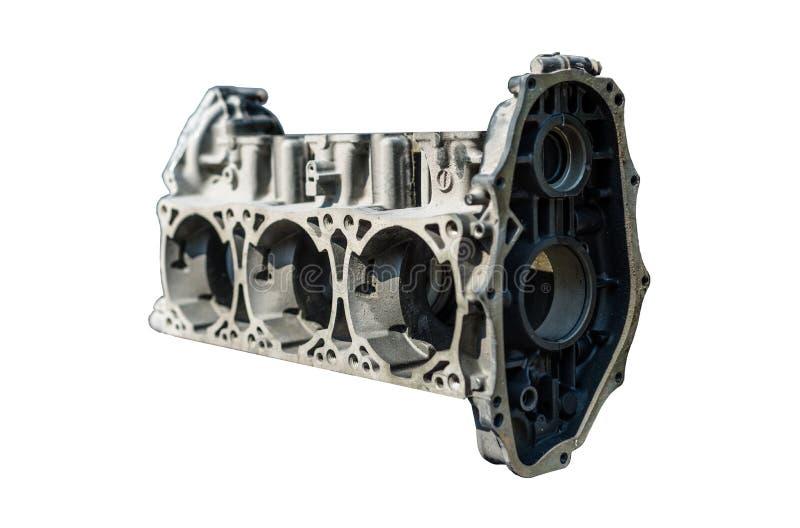 Desmontado de um bloco de motor do três-cilindro em um fundo branco com um trajeto de grampeamento fotografia de stock royalty free