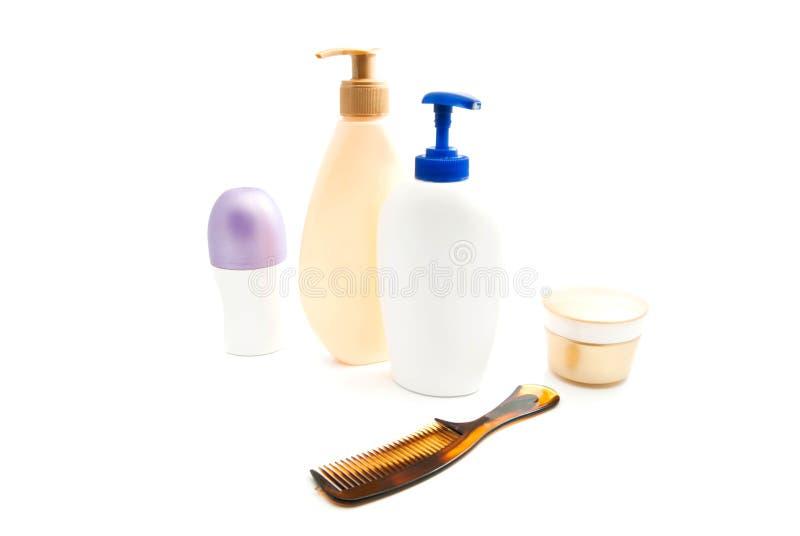 Desodorante, gel, crema y cepillo para el pelo foto de archivo