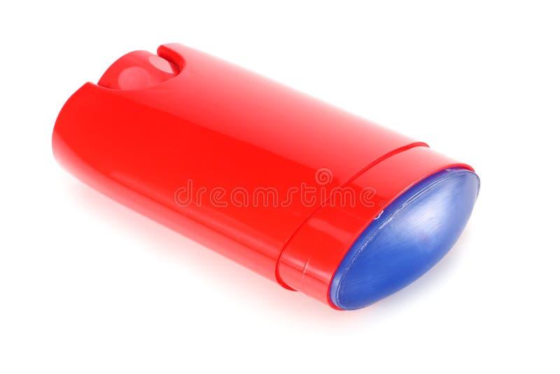 desodorierendes Mittel des roten Mannes lokalisiert auf weißem Hintergrund lizenzfreies stockfoto