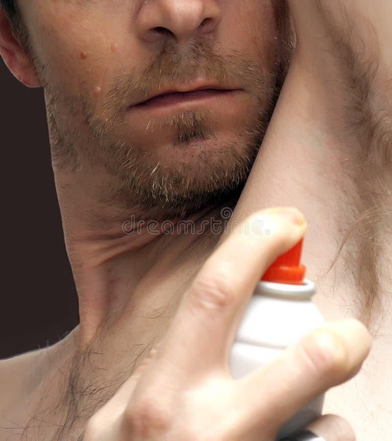 Desodorizante de pulverização do homem foto de stock royalty free