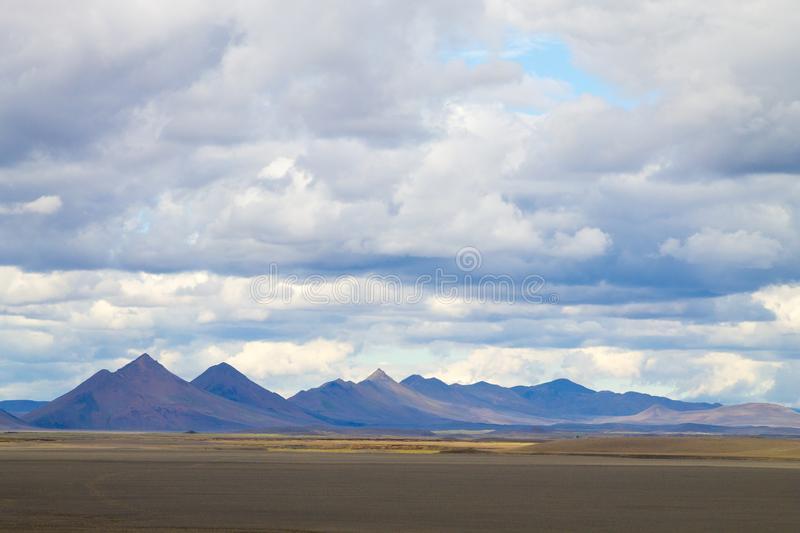 Desolate landscape along central highlands of Iceland. Iceland panorama. Route F907, vatnajokull, national, park, area, background, beautiful, beauty, blue royalty free stock images