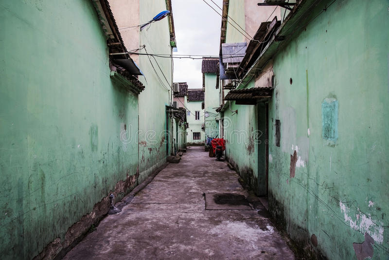 Desolate side alley in ancient Chinese town. Dismal side street in ancient Chinese town in Shanghai stock photo