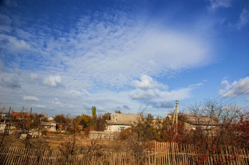 Desolate village. Autumn view of desolate village with blue sky stock photos