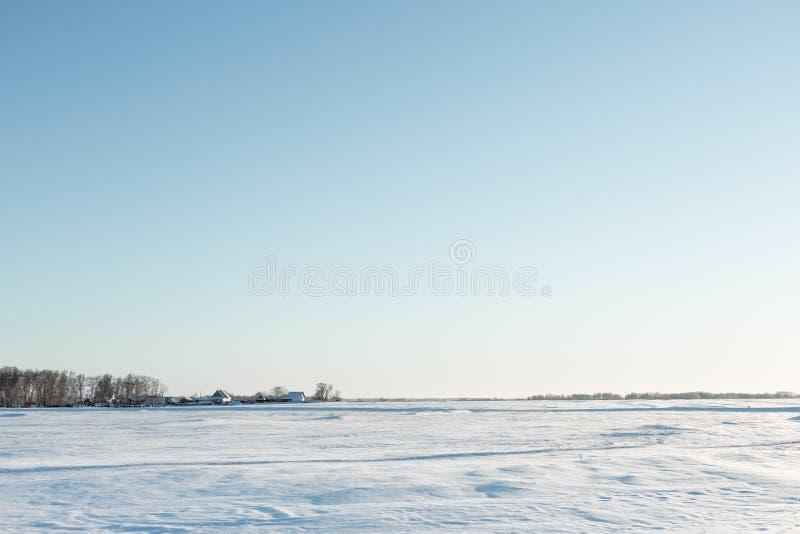 Desolate winter landscape near the village stock photo