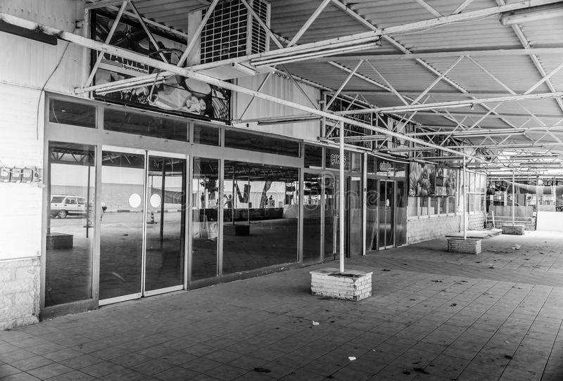 Desolated Grocery Store Building. A desolated building used to be a grocery store. Conceptual editorial photography to reflect the life in an average small stock images