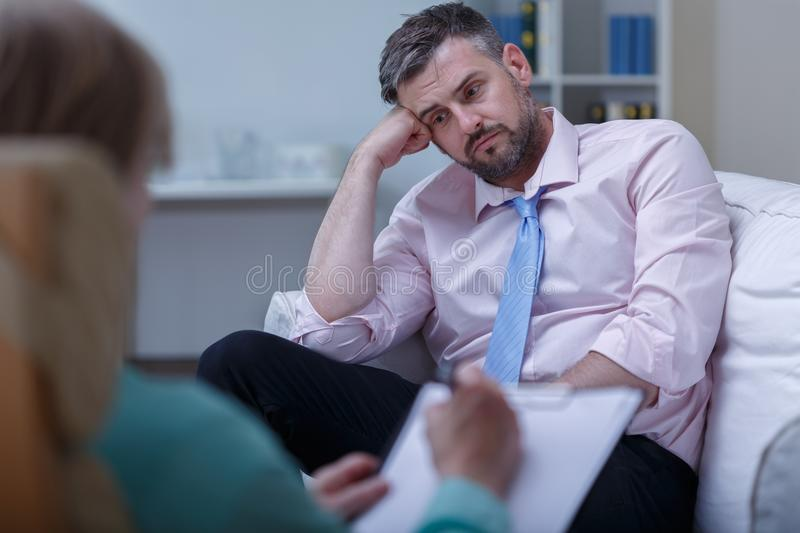 Despair businessman during psychotherapy royalty free stock photos