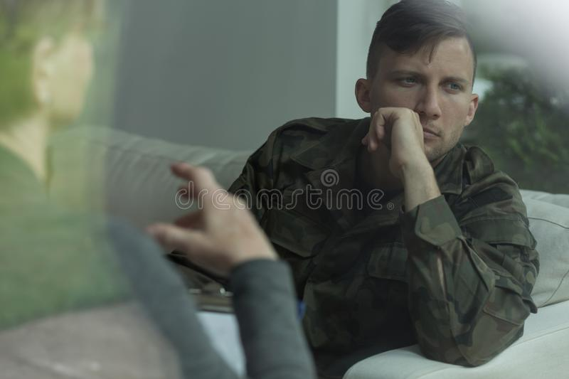 Despair soldier receiving psychological advice. During therapy stock photo