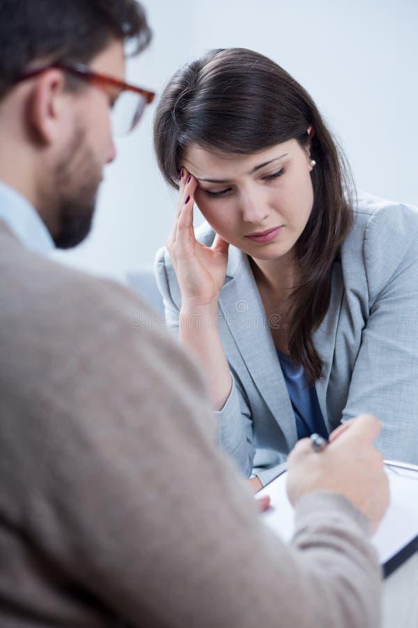 Despair woman receiving psychotherapy. Vertical view of despair women receiving psychotherapy stock photos