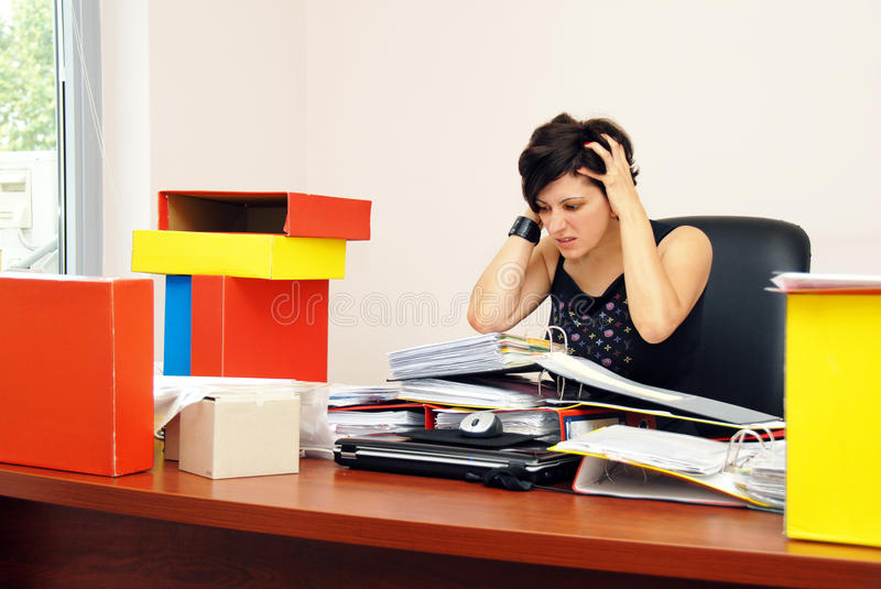 Despaired woman overloaded with work royalty free stock image
