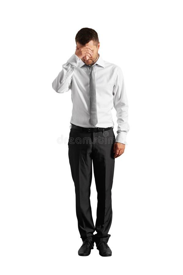 Despairing businessman. Full length photo of despairing businessman. isolated on white background royalty free stock photos