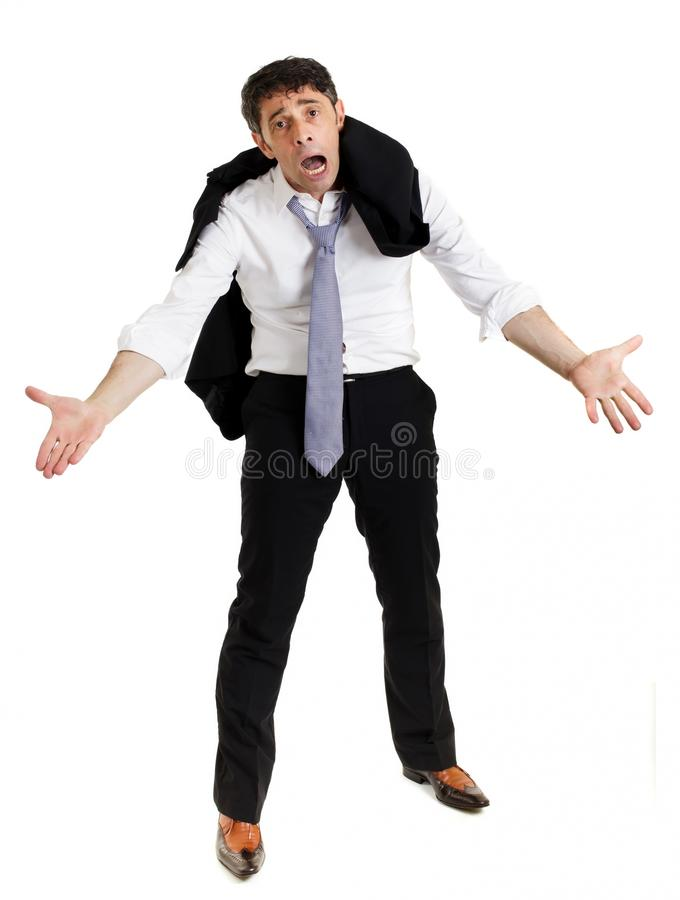 Despairing businessman. Standing with hunched shoulders, outstretched imploring hands and an anguished expression, isolated on white stock photography