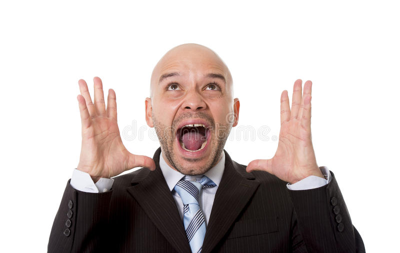 Desperate Brazilian bald businessman screaming and shouting crazy stress with mad face expression in overwork concept stock photography