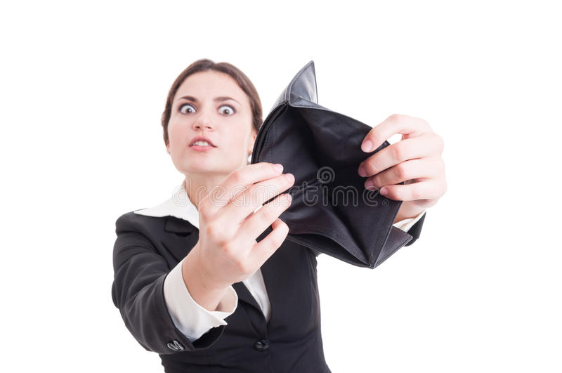 Desperate business woman showing empty wallet stock photo