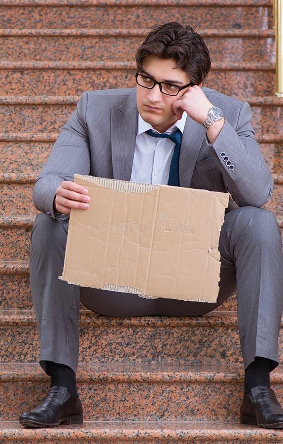 Desperate businessman begging on the street stock photos