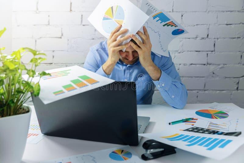 desperate businessman doing paperwork in office stock photos