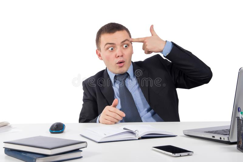 Desperate businessman pointing his finger to his head in a shoot himself after receiving news royalty free stock photo