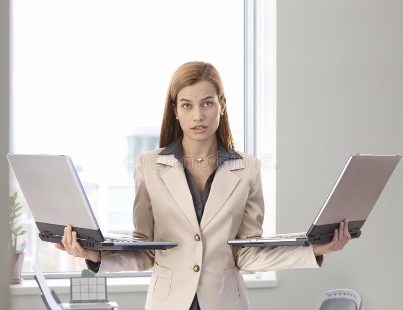 Download Desperate Businesswoman With Two Laptops Stock Image - Image: 23992865