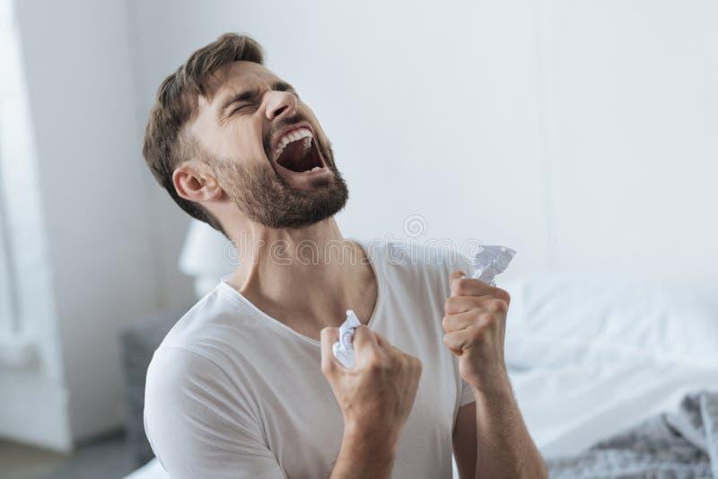 Desperate devastated man having a nervous breakdown royalty free stock images