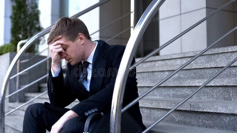 Desperate director thinking of company problem, bankruptcy depression, crisis royalty free stock image