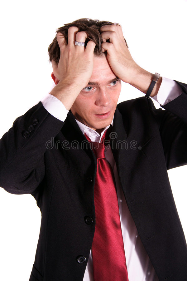Desperate employee. A handsome business man in desperate mood stock photos