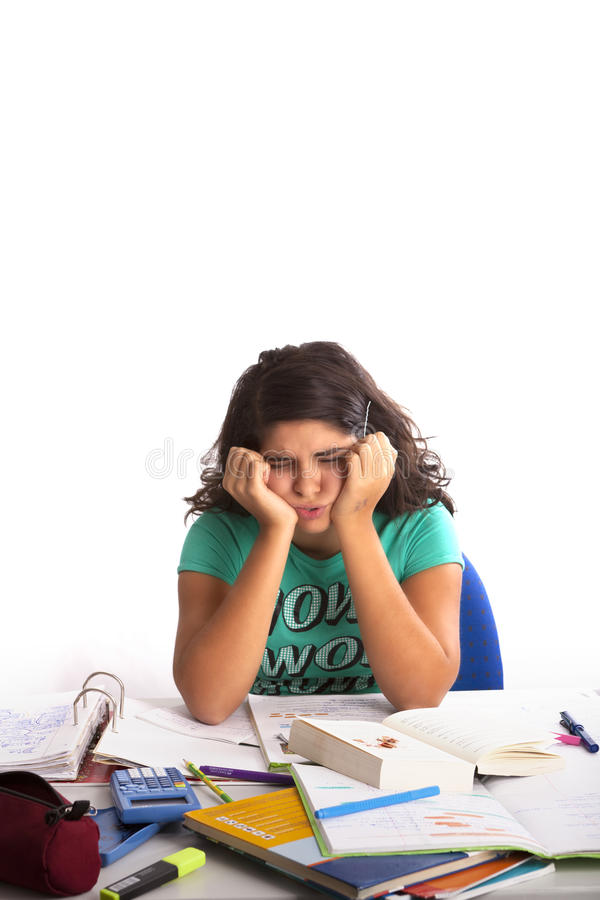 Desperate Girl with a lot of Homework royalty free stock photography