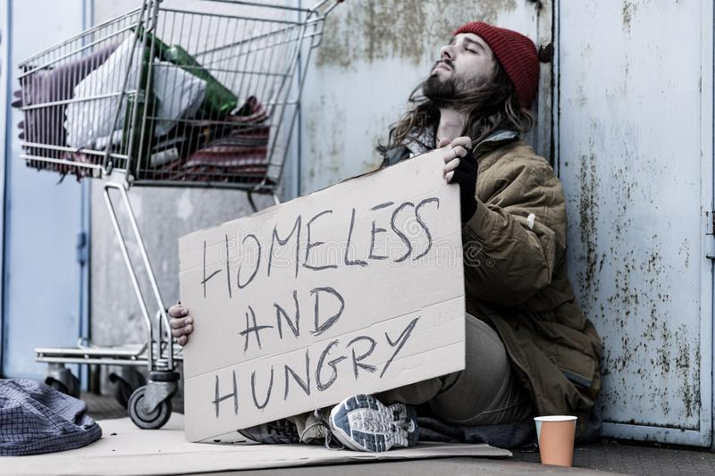 Desperate homeless and hungry tramp stock image