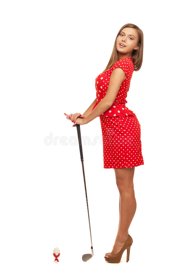 Desperate housewive. About to smash up egg with golf club stock photo