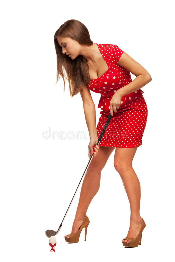 Desperate housewive. About to smash up egg with golf club royalty free stock images