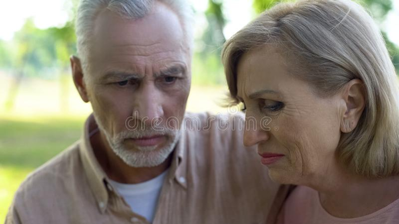 Desperate husband and wife thinking of problem, health problem, looking stressed royalty free stock image