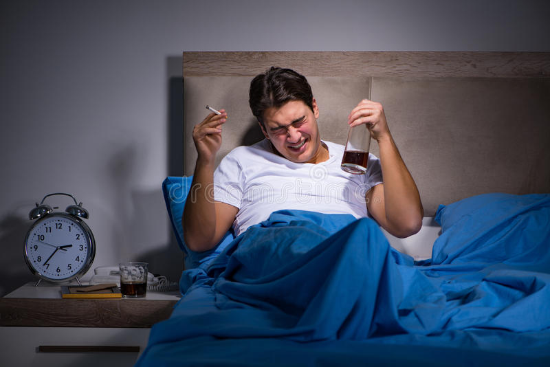 The desperate man divorced in bed. Desperate man divorced in bed royalty free stock photos