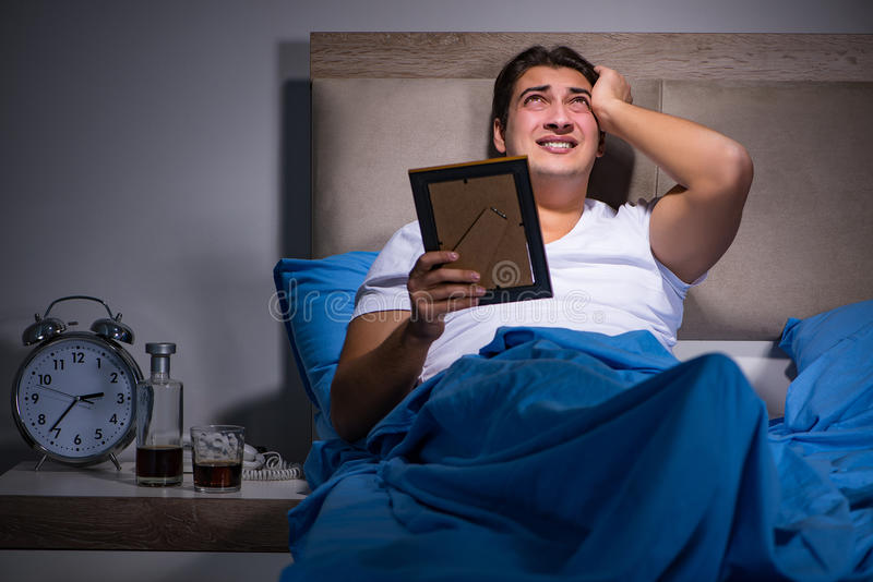 The desperate man divorced in bed. Desperate man divorced in bed stock photography